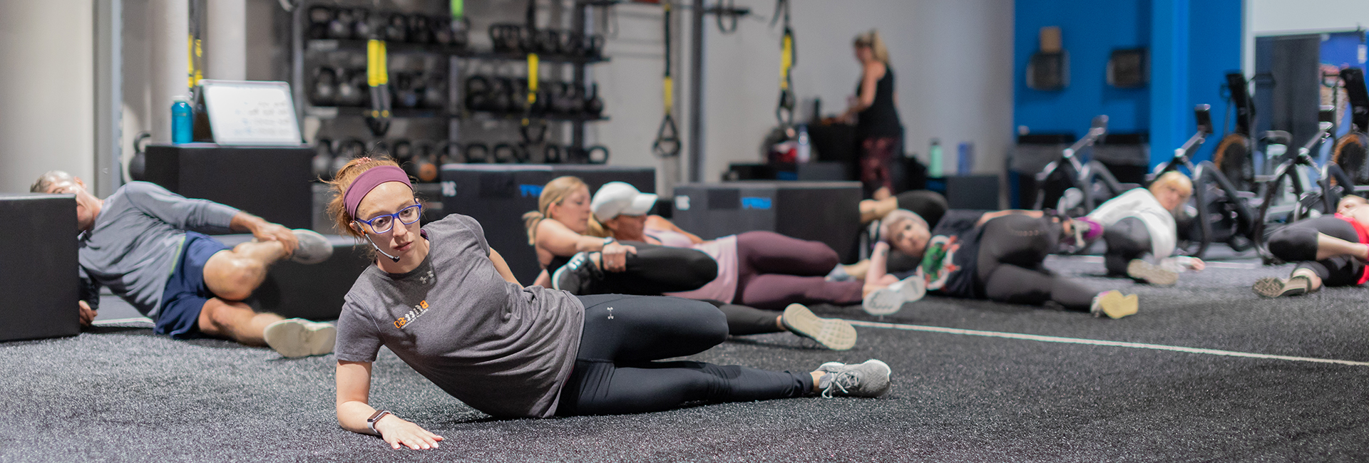 instructor teaching classes at fitness studio near me