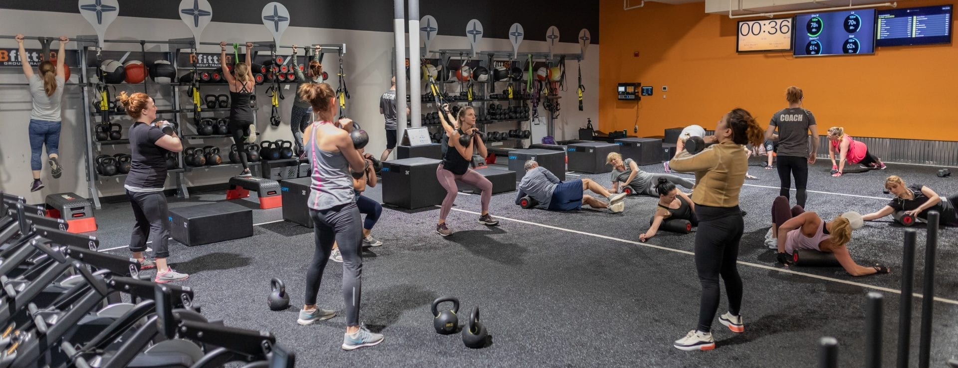 group training class in modern fitness center studio
