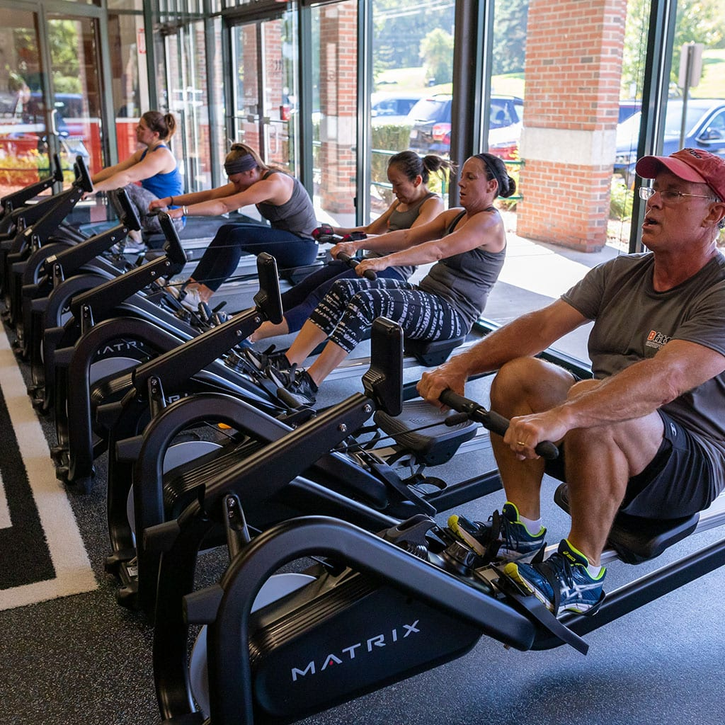 gym members using rowing machines