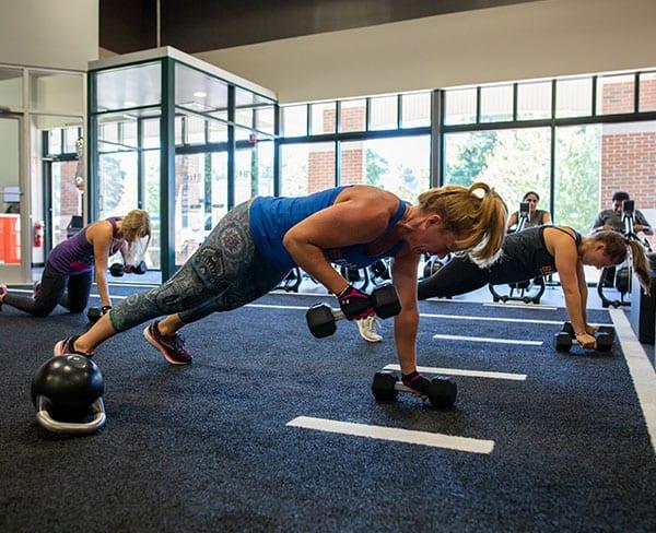 women doing pushups in fitness studio